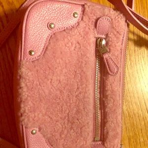 Small Coach purse with strap.